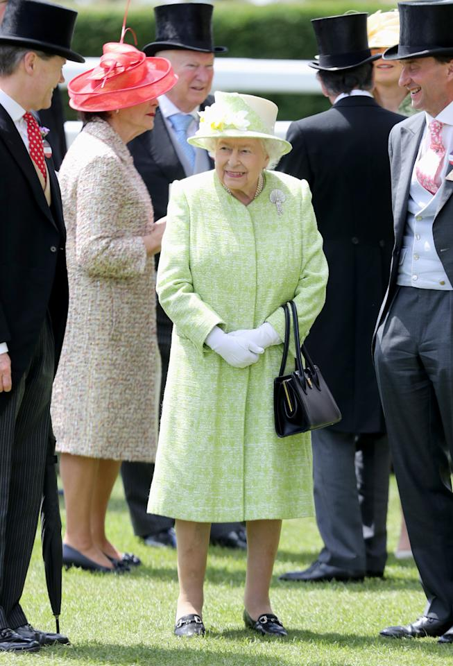 The Queen chose a muted lime coat with a matching floral hat for the final day of Royal Ascot. <em>[Photo: Getty]</em>