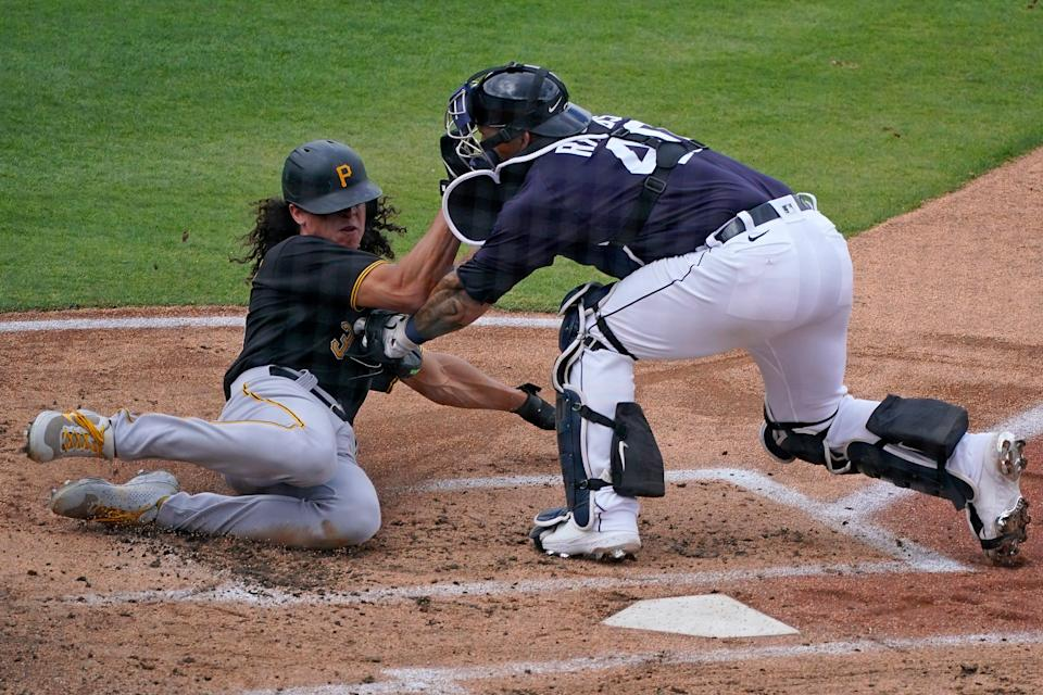 Pittsburgh Pirates' Cole Tucker (3) is tagged out at home plate by Detroit Tigers catcher Wilson Ramos during the second inning in Lakeland, Florida, on Saturday, March 20, 2021.