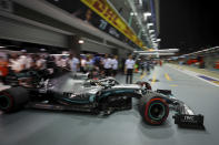 Mercedes driver Lewis Hamilton of Britain pulls out of his garage during the second practice session at the Marina Bay City Circuit ahead of the Singapore Formula One Grand Prix in Singapore, Friday, Sept. 20, 2019. (AP Photo/Vincent Thian)