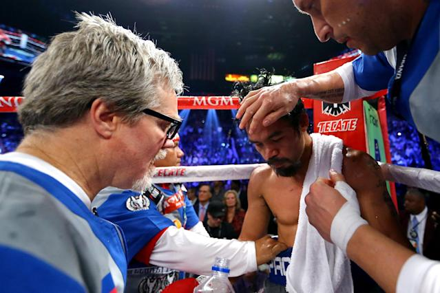 LAS VEGAS, NV - DECEMBER 08: (L-R) Trainer Freddie Roach talks with Manny Pacquiao between rounds against Juan Manuel Marquez during their welterweight bout at the MGM Grand Garden Arena on December 8, 2012 in Las Vegas, Nevada. (Photo by Al Bello/Getty Images)