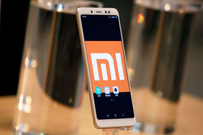FILE PHOTO: A company logo of Xiaomi is displayed on its smartphone in Hong Kong