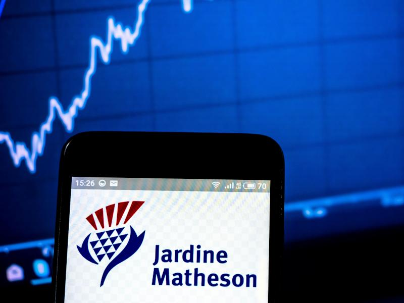 UKRAINE - 2019/03/24: In this photo illustration a Jardine Matheson Holdings Limited logo seen displayed on a smart phone. (Photo Illustration by Igor Golovniov/SOPA Images/LightRocket via Getty Images)