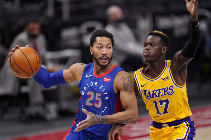 Detroit Pistons guard Derrick Rose (25) looks to pass as Los Angeles Lakers guard Dennis Schroder (17) defends during the second half of an NBA basketball game, Thursday, Jan. 28, 2021, in Detroit. (AP Photo/Carlos Osorio)
