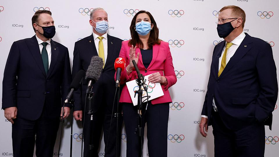 Annastacia Palaszczuk and John Coates, pictured here speaking to the media in Tokyo.