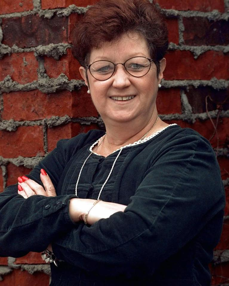 """FILE - In this Jan. 8, 1998 file photo, Norma McCorvey poses in Dallas . McCorvey, whose legal challenge under the pseudonym """"Jane Roe"""" led to the U.S. Supreme Court's landmark decision that legalized abortion but who later became an outspoken opponent of the procedure, died Saturday, Feb. 18, 2017. She was 69. McCorvey died at an assisted living center in Katy, Texas, said journalist Joshua Prager, who is working on a book about McCorvey and was with her and her family when she died. He said she died of heart failure. (AP Photo/Eric Gay)"""
