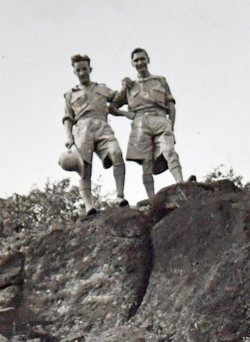 John Cox (left) during his time in the army. (PA Images)