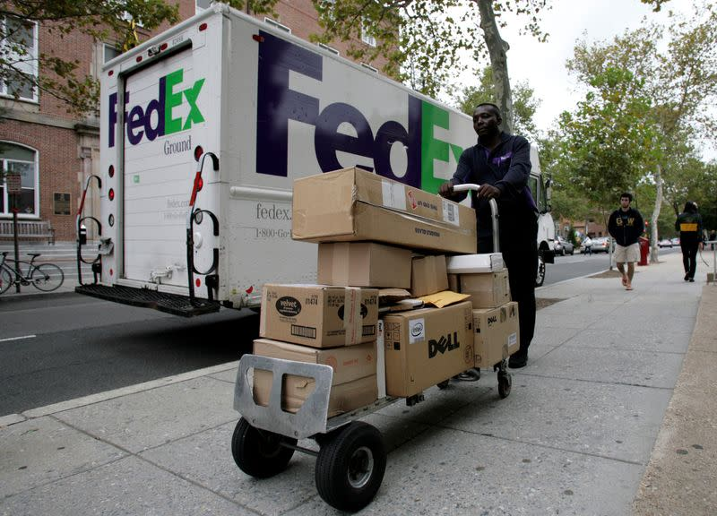 FILE PHOTO: A FedEx driver delivers packages in Washington