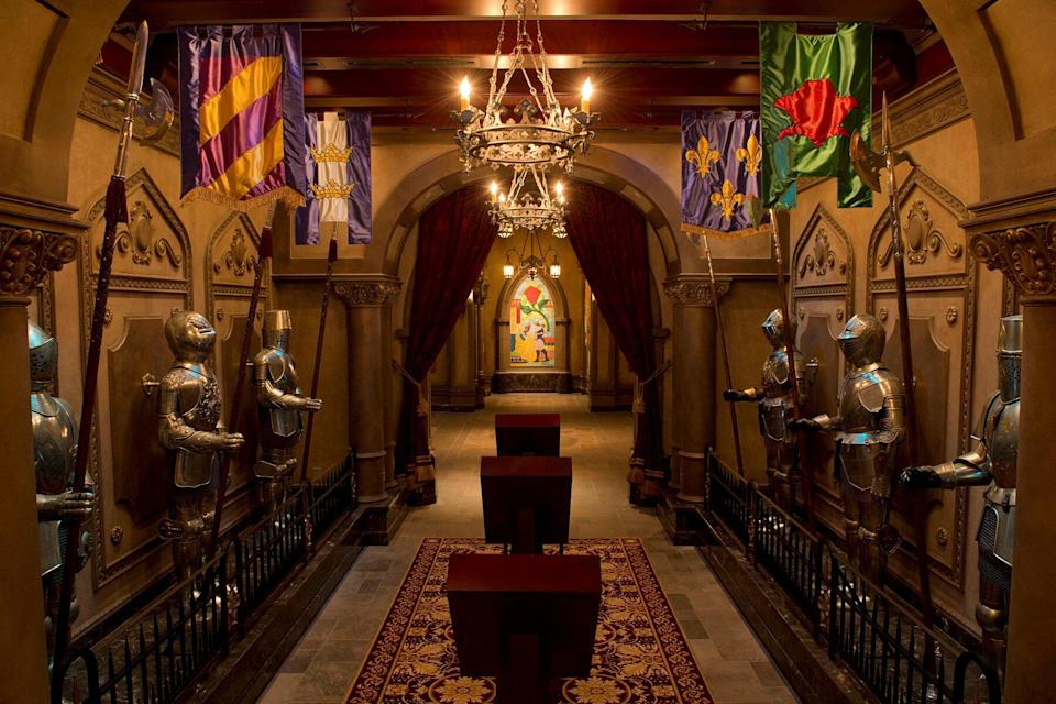 Flanked with suits of armor, this mysterious hallway leads Magic Kingdom guests into Beast's Castle for quick-service lunch cuisine at Be Our Guest Restaurant.