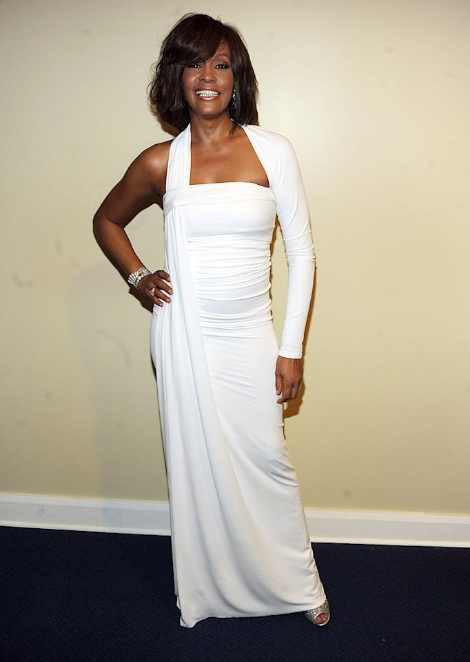 "This week's other vision in white was undoubtedly Whitney Houston, who returned to form at the AMAs in a fabulous one-shoulder Kaufman Franco column gown and a genuine smile. Kevin Mazur/<a href=""http://www.wireimage.com"" target=""new"">WireImage.com</a> - November 22, 2009"