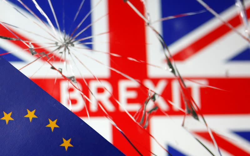EU flag are placed on broken glass and British flag in this illustration picture taken
