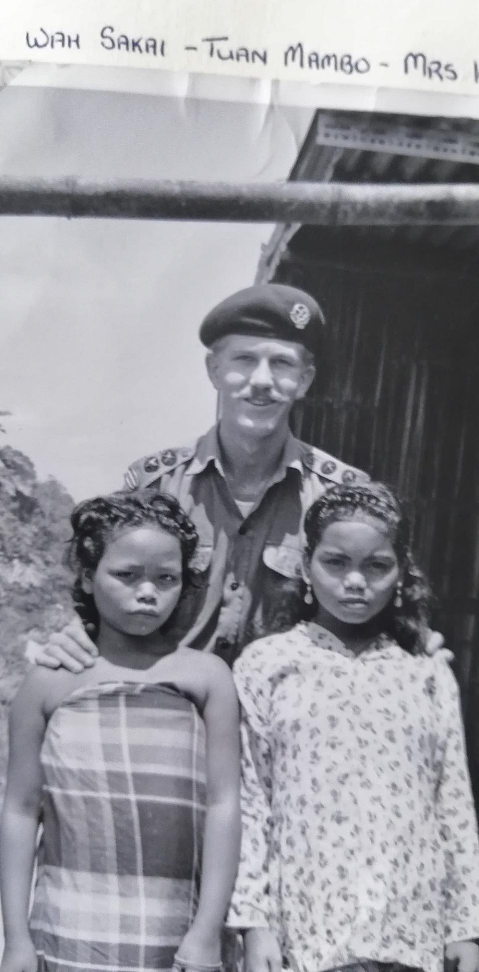 Lt. Peter Julius poses with two Orang Asli females, whom he named as Wah Sakai (left) and Mrs. Kun.  — Picture courtesy of Peter Julius