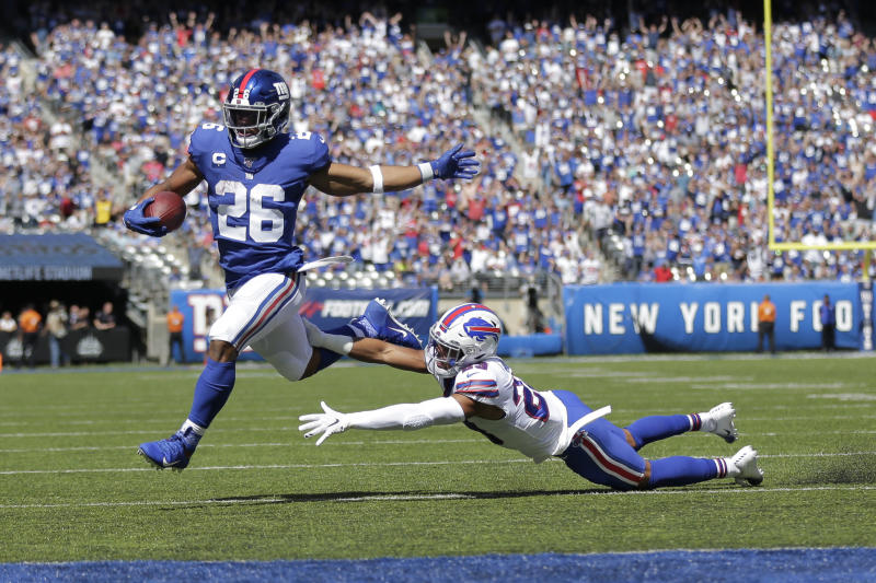 New York Giants running back Saquon Barkley (26) breaks away for a touchdown during the first half of an NFL football game against the Buffalo Bills, Sunday, Sept. 15, 2019, in East Rutherford, N.J. (AP Photo/Adam Hunger)