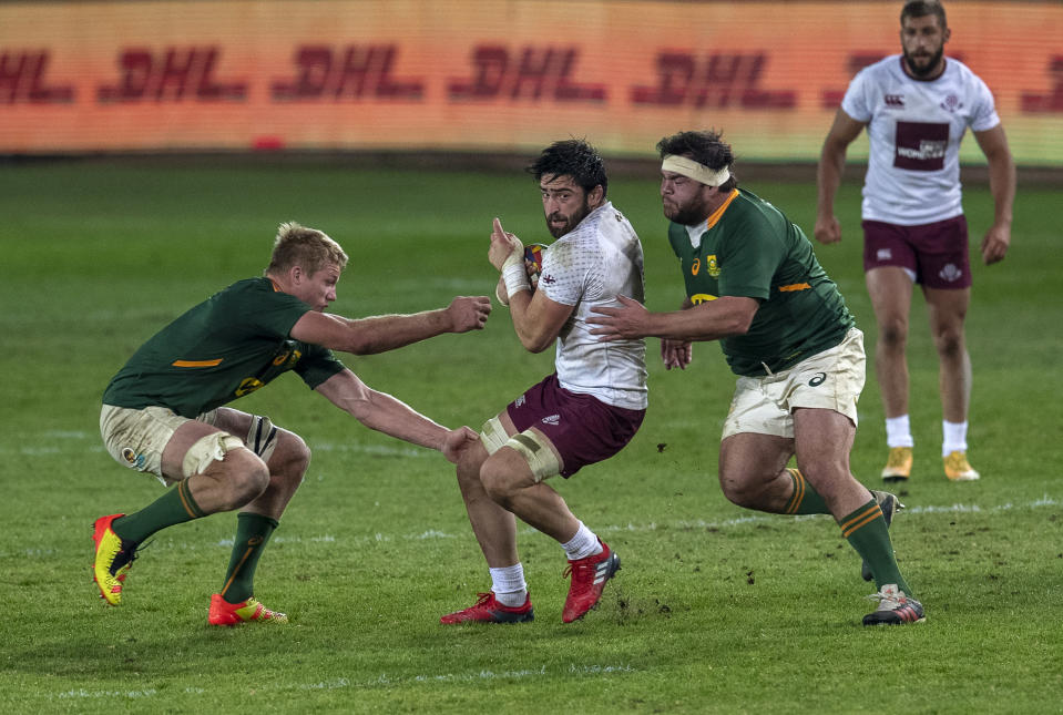 Georgia's Beka Saginadze, middle, is challenged by South Africa's Pieter Steph du Toit, left, and teammate Frans Malherbe during first test rugby match between South Africa and Georgia at Loftus Versfeld in Pretoria, South Africa, Friday, July 2, 2021. (AP Photo/Themba Hadebe)