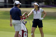 Albane Valenzuela, of Switzerland, laughs with her brother and caddy, Alexis Valenzuela, on the 11th fairway during a practice round prior to the women's golf event at the 2020 Summer Olympics, Monday, Aug. 2, 2021, at the Kasumigaseki Country Club in Kawagoe, Japan. (AP Photo/Matt York)