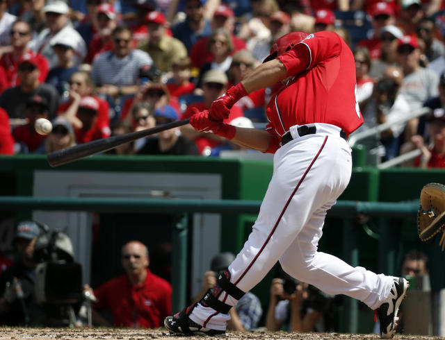 Washington Nationals catcher Wilson Ramos hits a two-RBI single during the fifth inning of a baseball game against the New York Mets at Nationals Park Sunday, May 18, 2014, in Washington. (AP Photo/Alex Brandon)