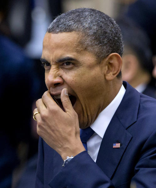 U.S. President Barack Obama yawns at the beginning of the East Asian Summit Plenary Session at the Peace Palace in Phnom Penh, Cambodia, Tuesday, Nov. 20, 2012. (AP Photo/Carolyn Kaster)
