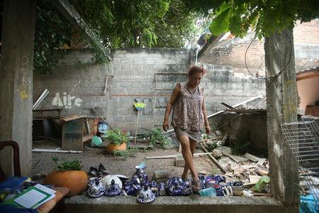 Felina, 50, an indigenous Zapotec transgender woman also know as Muxe, walks on the crockery inside her house destroyed after an earthquake that struck on the southern coast of Mexico late on Thursday, in Juchitan, Mexico, September 10, 2017. REUTERS/Edgard Garrido