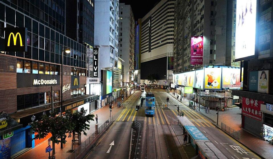 A usually bustling Causeway Bay is deserted as the storm nears. Photo: Robert Ng