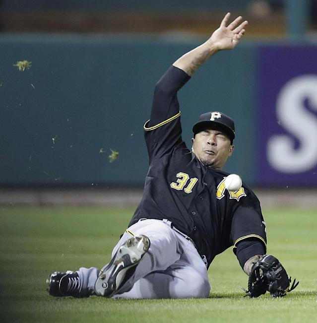 Pittsburg Pirates left fielder Jose Tabata misses a single fly ball by St. Louis Cardinals' Daniel Descalso during the eighth inning of Game 5 of a National League baseball division series, Wednesday, Oct. 9, 2013, in St. Louis. The Cardinals won 6-1, and advanced to the NL championship series against the Los Angeles Dodgers. (AP Photo/Charlie Riedel)