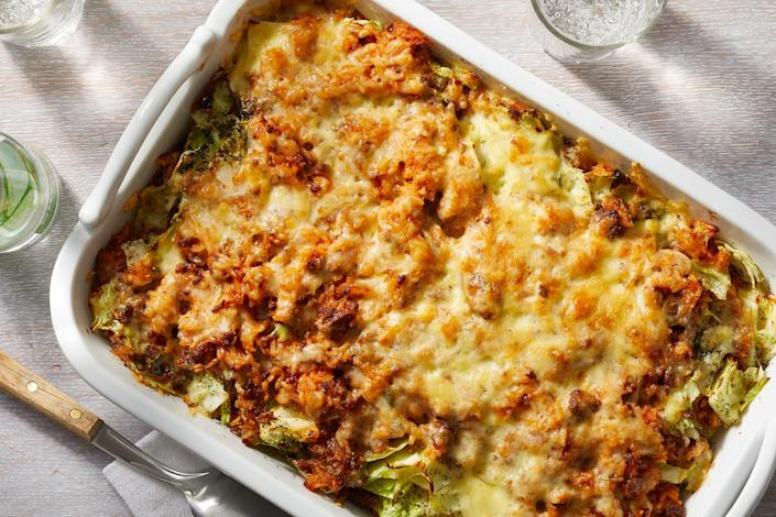 """<p>This casserole has all the elements of cabbage rolls—ground beef, onion and rice cooked in tomato sauce—and skips the fuss of rolling. The cabbage is chopped instead and layered with the saucy filling, then topped with cheese, for a satisfying and easy casserole. Feel free to substitute other ground meats, such as turkey, for the ground beef—this recipe would also be great with a vegetarian meat substitute. <a href=""""https://www.eatingwell.com/recipe/7901097/cabbage-roll-casserole/"""" rel=""""nofollow noopener"""" target=""""_blank"""" data-ylk=""""slk:View Recipe"""" class=""""link rapid-noclick-resp"""">View Recipe</a></p>"""