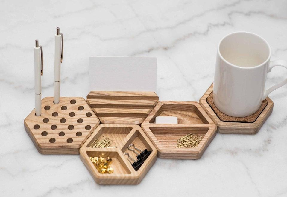 <p>Elevate their desk with the help of this <span>Wooden Office Desk Organizer</span> ($9). It can hold everything from pens to coffee cups.</p>