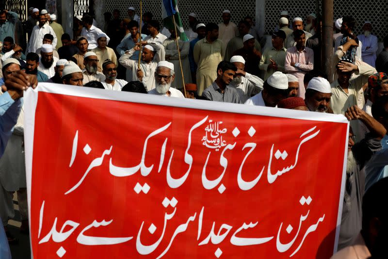 FILE PHOTO: Supporters of religious and political party Jamaat-e-Islami listen to the speech of their leader during a protest in Karachi