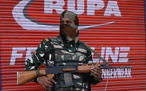 An Indian paramilitary trooper stands guard in Srinagar - Credit: TAUSEEF MUSTAFA/AFP/Getty Images