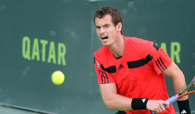 Andy Murray of Great Britain returns the ball to Florian Mayer of Germany during the Qatar ATP Open Tennis tournament in Doha, Qatar, Wednesday, Jan. 1, 2014.(AP Photo/Osama Faisal)