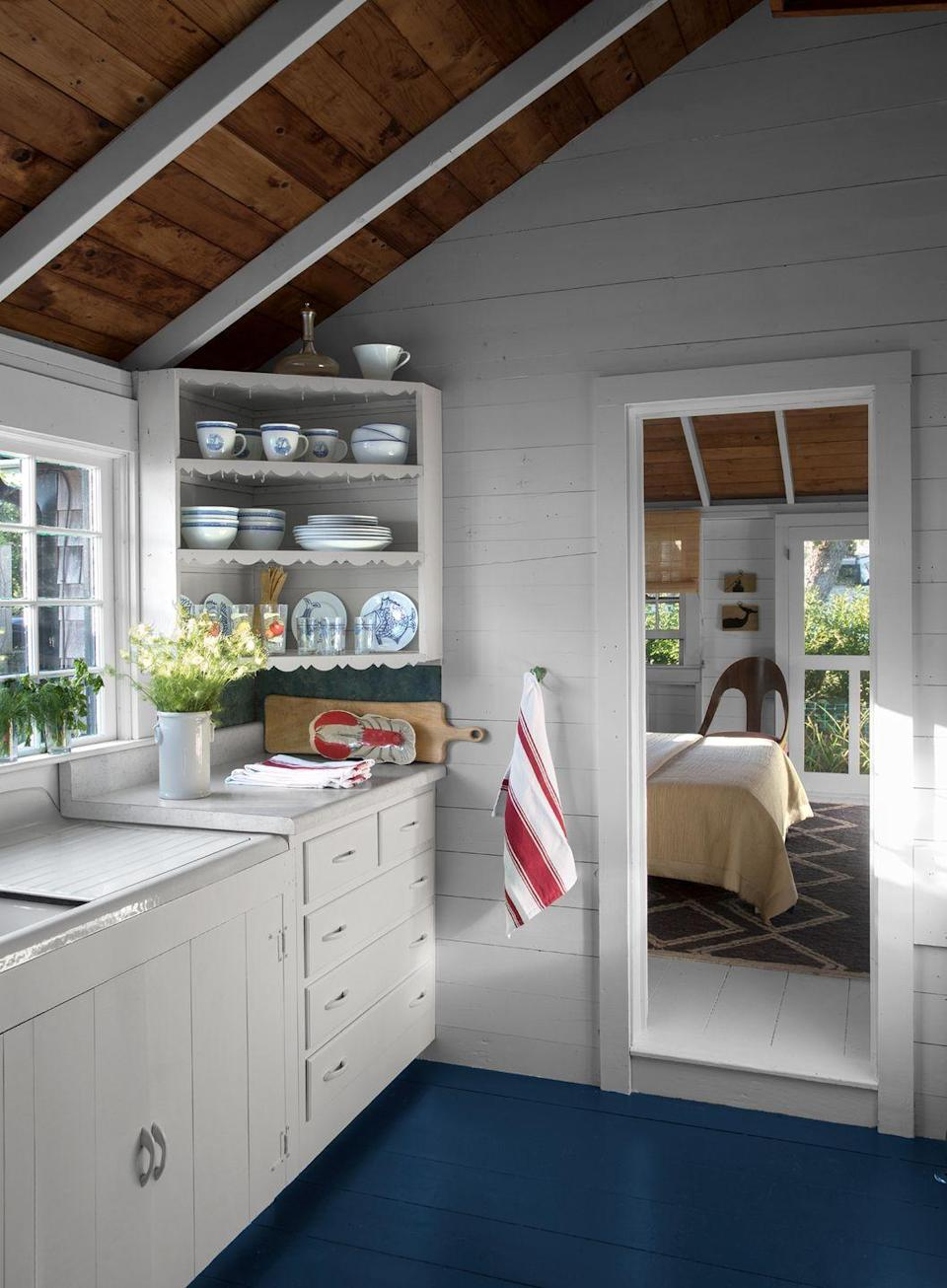 """<p>Designer Kevin Isbell completely revamped this antique fishing shack to make it feel fresh and clean while still keeping it approachable and grounded. For a similar feel in your kitchen, swap out a paper towel wall dispenser with a wall hook for a prettier hand towel. Then tuck your trashcan under the sink instead of keeping in plain sight. </p><p><em><a href=""""https://www.housebeautiful.com/home-remodeling/interior-designers/a15063444/kevin-isbell-interview/"""" rel=""""nofollow noopener"""" target=""""_blank"""" data-ylk=""""slk:See more at House Beautiful »"""" class=""""link rapid-noclick-resp"""">See more at House Beautiful »</a></em></p><p><strong>What you'll need:</strong> Wall hook, $10, <a href=""""https://www.cb2.com/black-2-arm-hook/s673826"""" rel=""""nofollow noopener"""" target=""""_blank"""" data-ylk=""""slk:CB2.com"""" class=""""link rapid-noclick-resp"""">CB2.com</a></p>"""