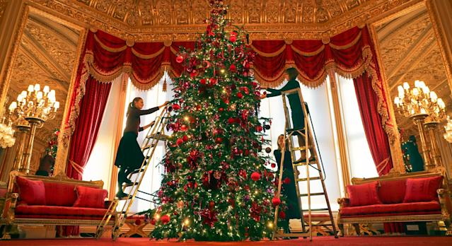 A Christmas tree standing at 15ft is decorated in the Queen's Windsor Castle [Image: PA Images]