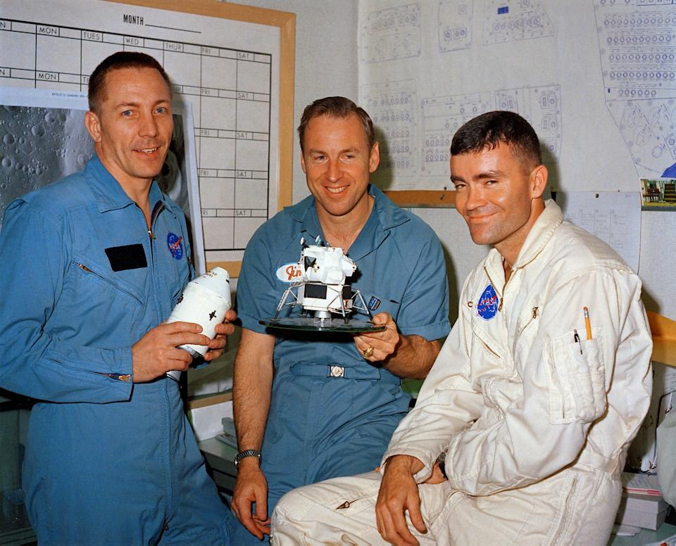 Apollo 13 astronauts Jack Swigert, Jim Lovell and Fred Haise seen with a model of their capsule on April 10, 1970, the day before they launched.