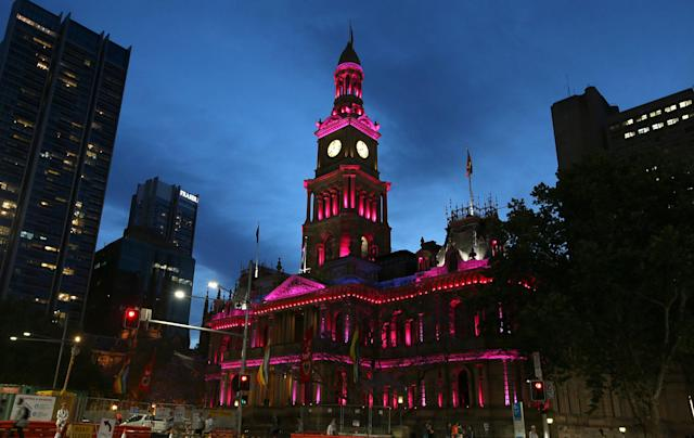 <p>Town Hall is lit up with pink lights as the gay community and their supporters celebrate the result of a postal survey calling for gay marriage right in Sydney, Australia, Wednesday, Nov. 15, 2017. (Photo: Rick Rycroft/AP) </p>