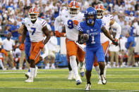 Kentucky wide receiver Wan'Dale Robinson (1) runs the ball for a touchdown during the first half of an NCAA college football game against Florida in Lexington, Ky., Saturday, Oct. 2, 2021. (AP Photo/Michael Clubb)