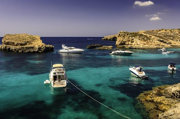 Boats on blue and turquoise water, Malta