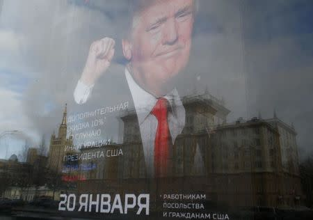 "An image of U.S. President-elect Donald Trump is seen on the advertising board of the store ""Army of Russia"", located opposite the U.S. embassy, in Moscow, Russia, January 20, 2017.  REUTERS/Sergei Karpukhin"