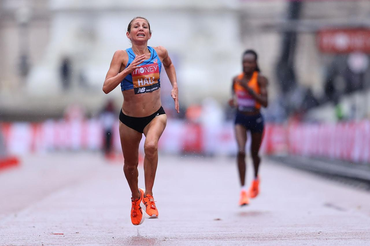 <p>Sara Hall picked up the pace in the final stretch of the race to take second place after passing Ruth Chepngetich</p>