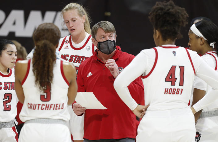 North Carolina State head coach Wes Moore talks with his team during the first half of an NCAA college basketball game against Clemson Reynolds Coliseum in Raleigh, N.C., Thursday, Feb. 11, 2021. (Ethan Hyman/The News & Observer via AP)