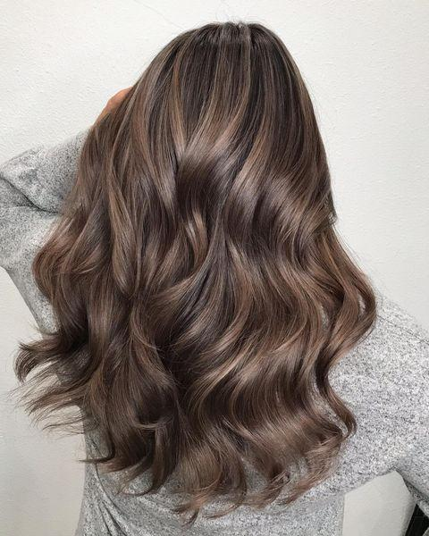"""<p>A teensy bit of mauve gives this ash-brown hair color <strong>a <em>slightly</em> purple tone when you look closely</strong>. And, like, can we just talk about how good this color looks when styled in loose <a href=""""https://www.cosmopolitan.com/style-beauty/beauty/how-to/a8624/how-to-get-beachy-waves/"""" rel=""""nofollow noopener"""" target=""""_blank"""" data-ylk=""""slk:beach waves"""" class=""""link rapid-noclick-resp"""">beach waves</a>?</p><p><a href=""""https://www.instagram.com/p/B9fpG3hp2Zw/"""" rel=""""nofollow noopener"""" target=""""_blank"""" data-ylk=""""slk:See the original post on Instagram"""" class=""""link rapid-noclick-resp"""">See the original post on Instagram</a></p>"""