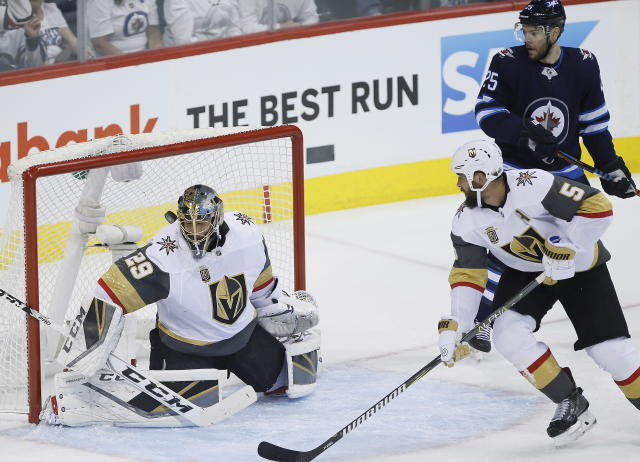 Winnipeg Jets' Patrik Laine, not seen, scores on Vegas Golden Knights goaltender Marc-Andre Fleury (29) as Jets' Paul Stastny and Golden Knights' Deryk Engelland watch during the first period of Game 1 of the NHL hockey playoffs Western Conference final, Saturday, May 12, 2108, in Winnipeg, Manitoba. (John Woods/The Canadian Press via AP)