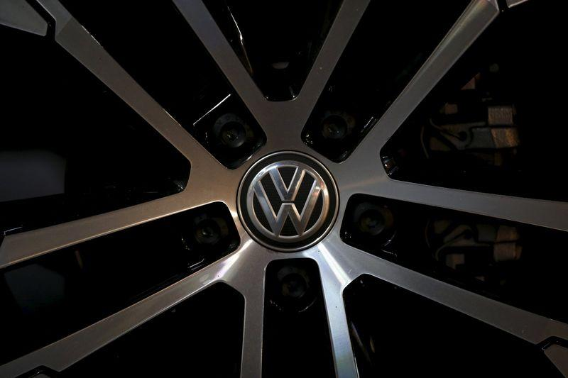A logo of Volkswagen is seen on a wheel of a Golf car parked at a dealership in Seoul