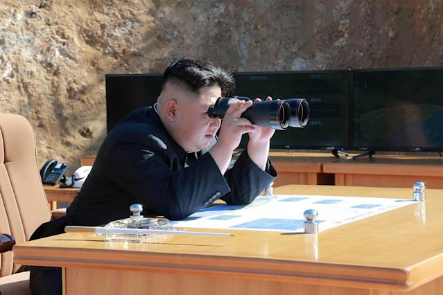 <p>North Korean Leader Kim Jong Un looks on during the test-fire of inter-continental ballistic missile Hwasong-14 in this undated photo released by North Korea's Korean Central News Agency (KCNA) in Pyongyang, July, 4 2017. (Photo: KCNA/via Reuters) </p>