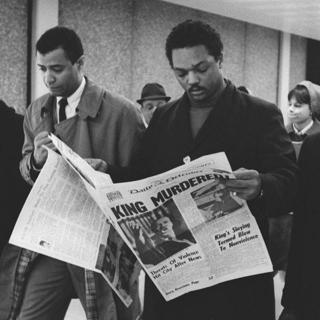 <p>Jesse Jackson, in Chicago, holds a copy of the Daily Defender, April 5, 1968. (Photo: Robert Abbott Sengstacke/Getty Images) </p>