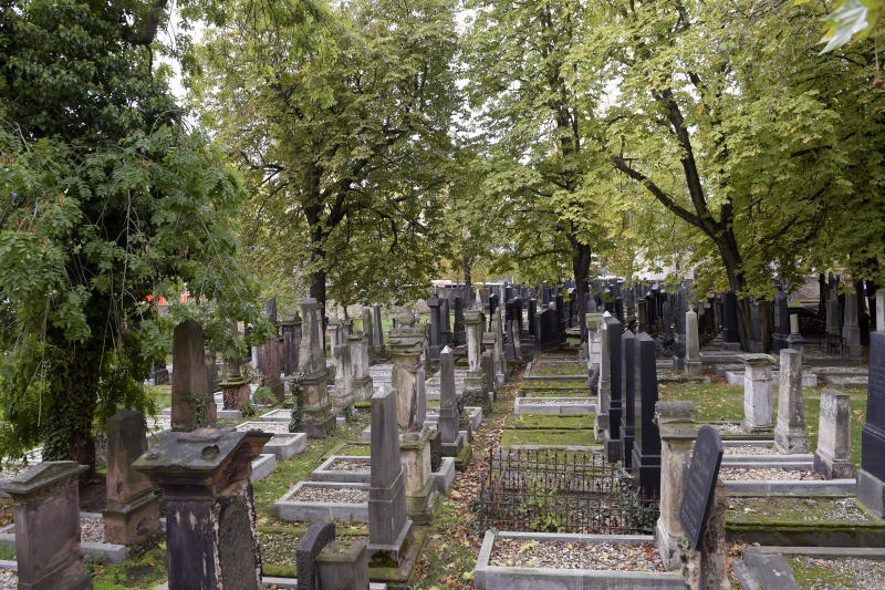 Tomb stones stand on a Jewish cemetery in Halle, Germany, Wednesday, Oct. 9, 2019. One or more gunmen fired several shots on Wednesday in the German city of Halle. Police say a person has been arrested after a shooting that left two people dead. (AP Photo Jens Meyer)