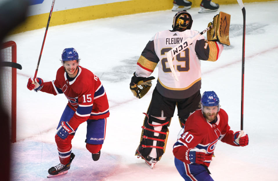 Montreal Canadiens' Jesperi Kotkaniemi, left, and Joel Armia celebrate a goal by Josh Anderson on Vegas Golden Knights goaltender Marc-Andre Fleury during the third period of Game 3 of an NHL hockey semifinal series, Friday, June 18, 2021, in Montreal. (Paul Chiasson/The Canadian Press via AP)