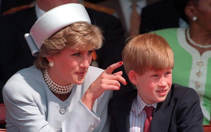 Diana, Princess of Wales with Prince Harry who has said he regrets not opening up sooner about how his mother's death affected him - Credit:  PA