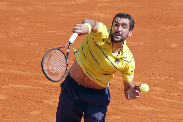 Croatia's Marin Cilic serves to Japan's Kei Nishikori during their quarterfinal match of the Monte Carlo Tennis Masters tournament in Monaco, Friday, April, 20, 2018. (AP Photo/Christophe Ena)