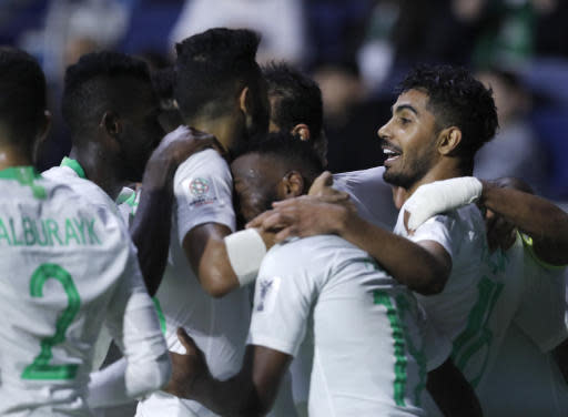 Saudi Arabia's midfielder Hussain Al-Mogahwi, right, celebrates his goal with his teammates during the AFC Asian Cup group E soccer match between Lebanon and Saudi Arabia at Al Maktoum Stadium in Dubai, United Arab Emirates, Saturday, Jan. 12, 2019. (AP Photo/Hassan Ammar)