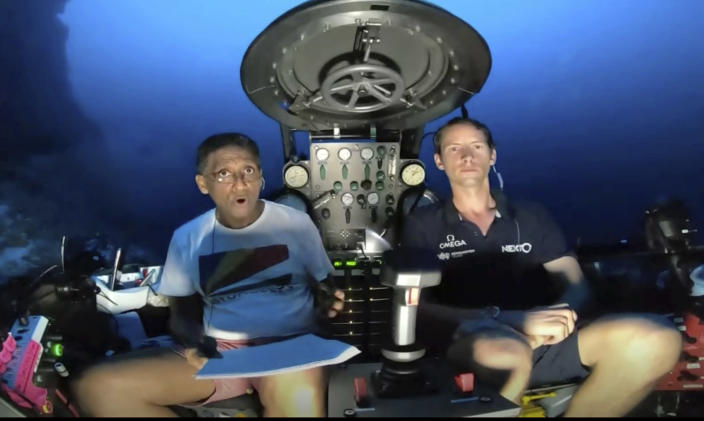 An image taken from video issued by Nekton shows Seychelles President Danny Faure, left, speaking from inside a submersible from the vessel Ocean Zephyr, under the water off the coast of Desroches, in the outer islands of Seychelles Sunday April 14, 2019. Faure toured the vessel and was presented with some of the findings and observations made by a British-led science expedition documenting changes taking place beneath the waves that could affect billions of people in the surrounding region over the coming decades (Nekton via AP)