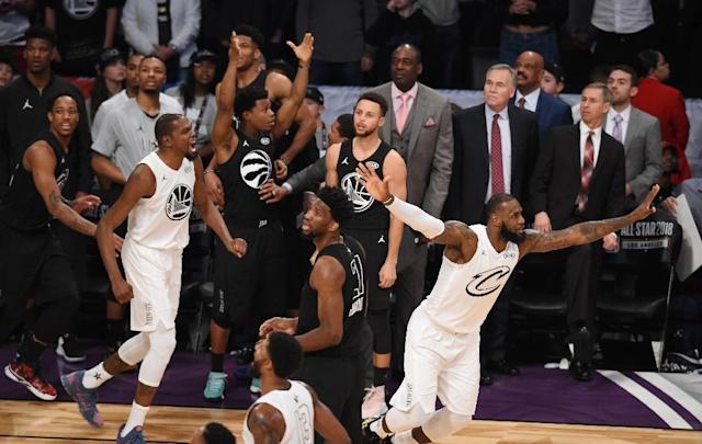 Kevin Durant (L) and LeBron James (R) of Team LeBron celebrate their 148-145 win over Team Stephen in the NBA All-Star Game (AFP Photo/Robyn Beck)
