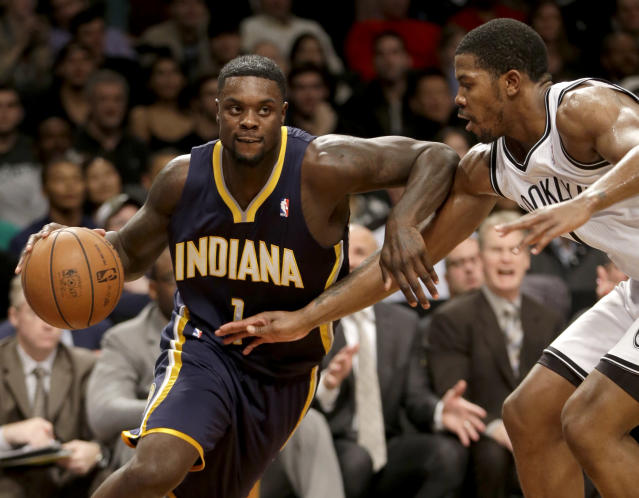 Indiana Pacers' Lance Stephenson, left, pushes past Brooklyn Nets' Joe Johnson during the first half of an NBA basketball game Monday, Dec. 23, 2013 in New York. (AP Photo/Seth Wenig)